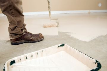 Painter painting garage floor in Mc Kinney
